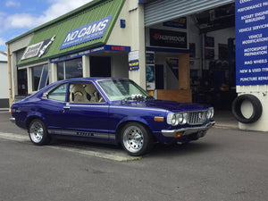 Mazda RX3 coupe fitted up with 14x7 Chrome Modgie wheels wrapped in 195/45r14 Falken tyres