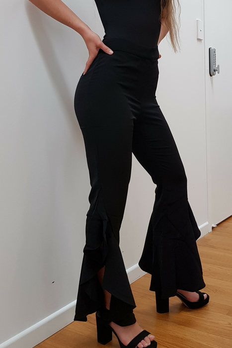 Obsessing Over these Ladies Pants. Black Kick Flare Ladies Pants. Perfect For Any Occasion. Online At The Sable Collection. Tailored Fit From The Top To The Knee, They Kick out In A Flare from The Knee With Open Slit. Material Is Polyester. It Has A Fiited Waistband With Zip And Button. False Back Pocket Detail.