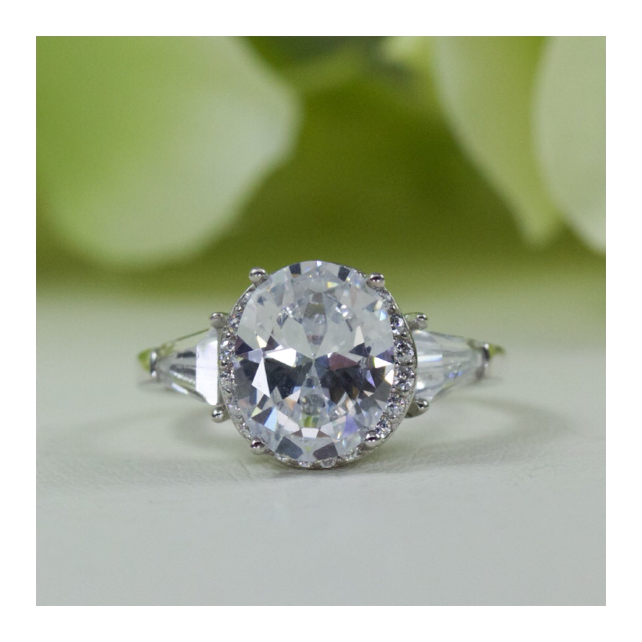 1aabf6fd3ba32 3.00 carat Oval With Baguette Cubic Zirconia Engagement Ring in Sterling  Silver