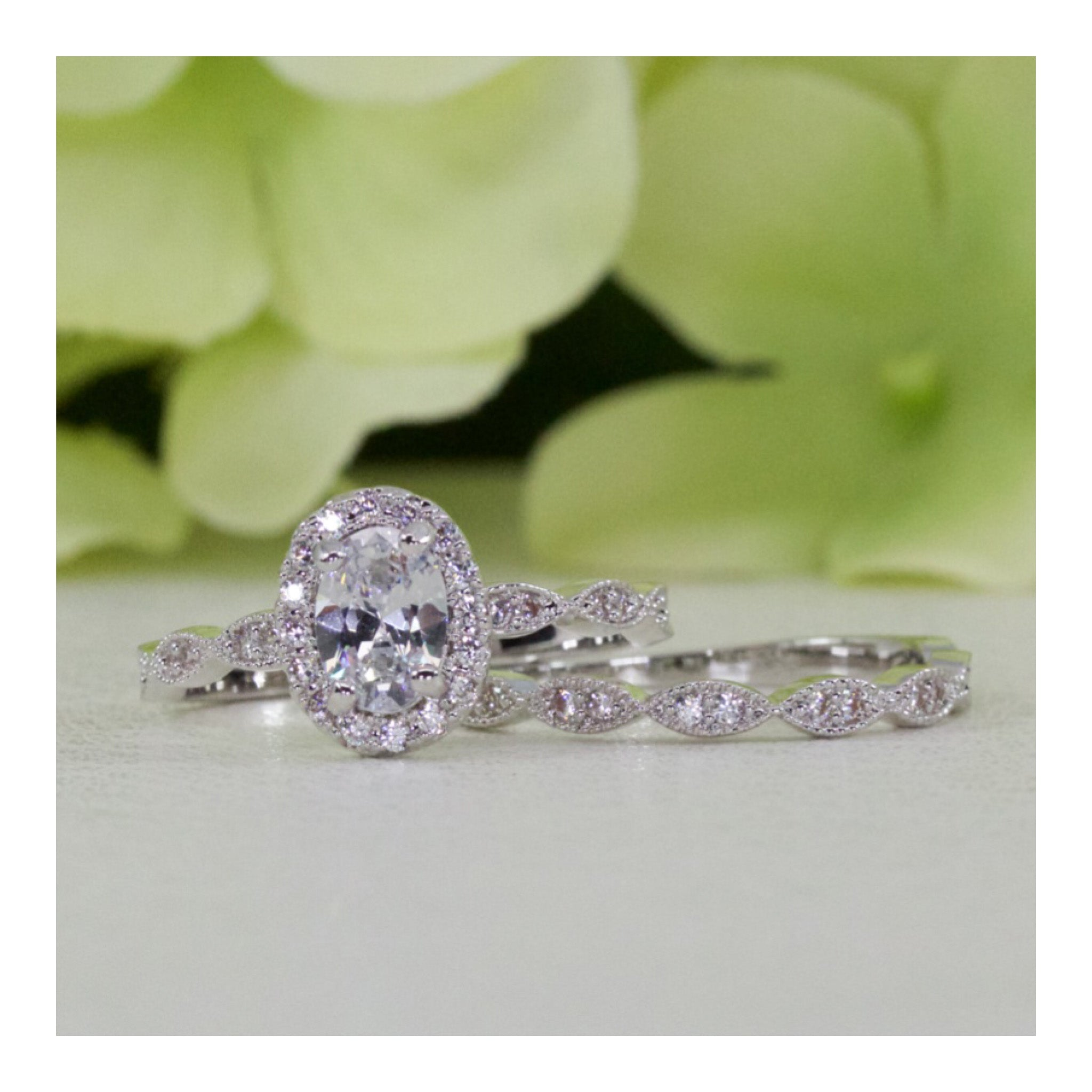 Halo Art Deco Style Oval Cz Engagement Ring In Sterling Silver
