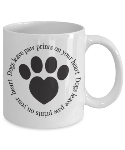Dogs leave paw prints on your heart. Mug