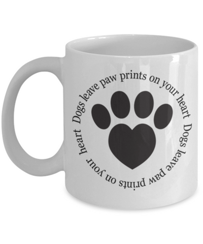 Image of Dogs leave paw prints on your heart. Mug