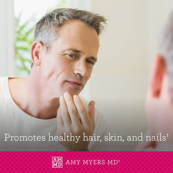 Man looking in mirror at healthy skin and hair - Amy Myers MD®