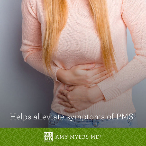 Woman holding mid-section - Estroprotect helps alleviate symptoms of PMS - Amy Myers MD®
