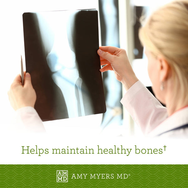 Doctor looking at x-rays - Magnesium Citrate helps maintain healthy bones - Amy Myers MD®