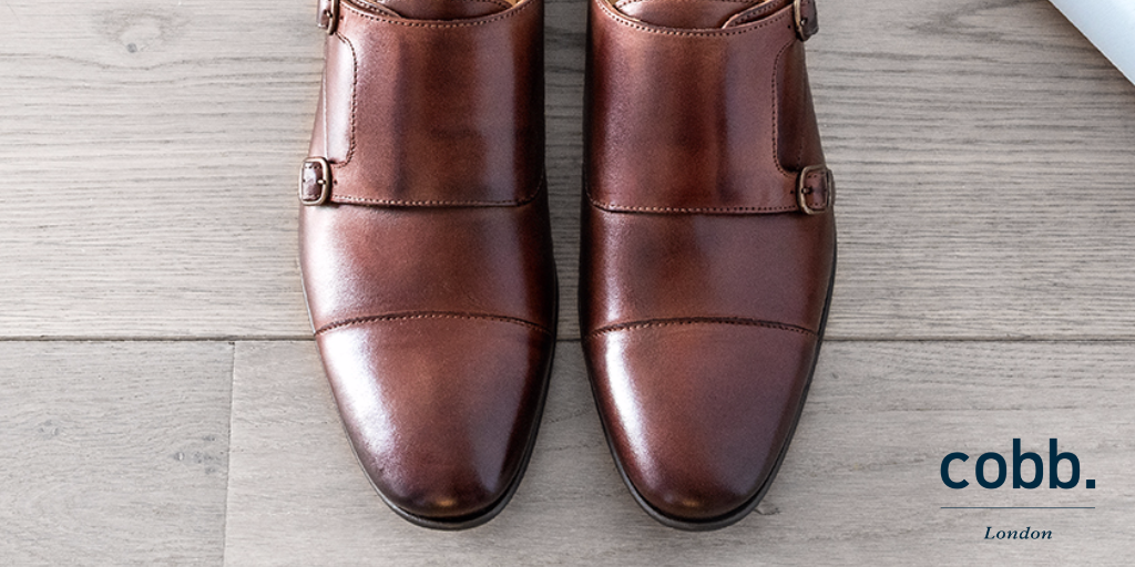 a pair of men's brown double monk strap shoes