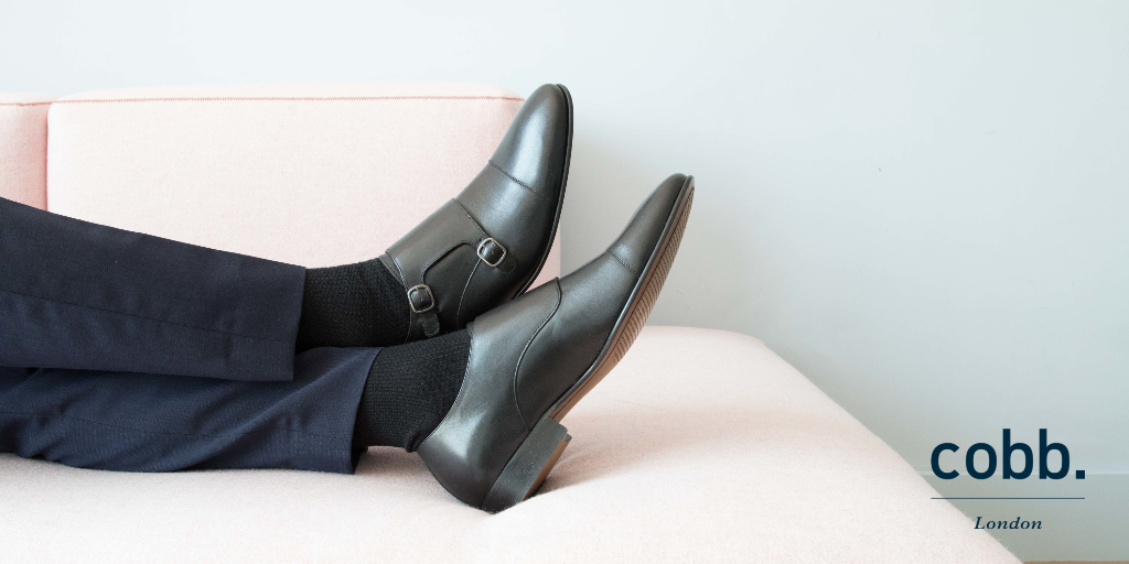 a man relaxing wearing men's black double monk strap shoes