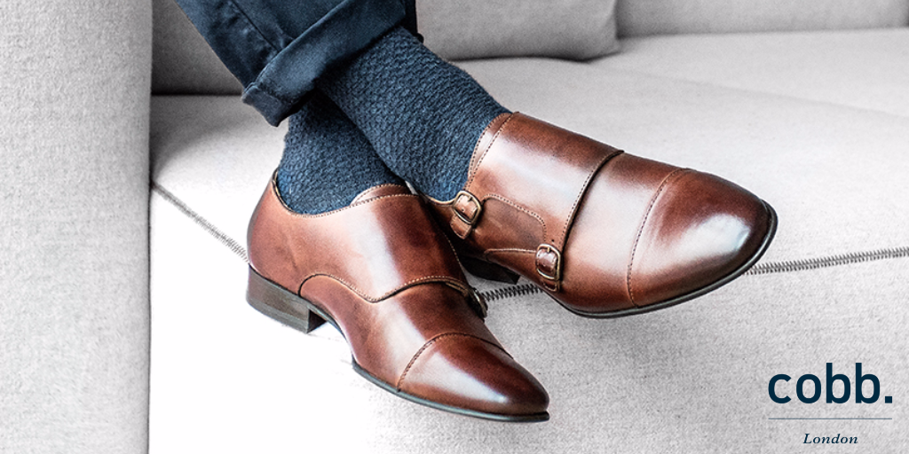 a man relaxing wearing men's brown double monk strap shoes