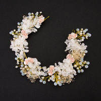 Delicate floral fabric, rhinestone and pearl hair piece