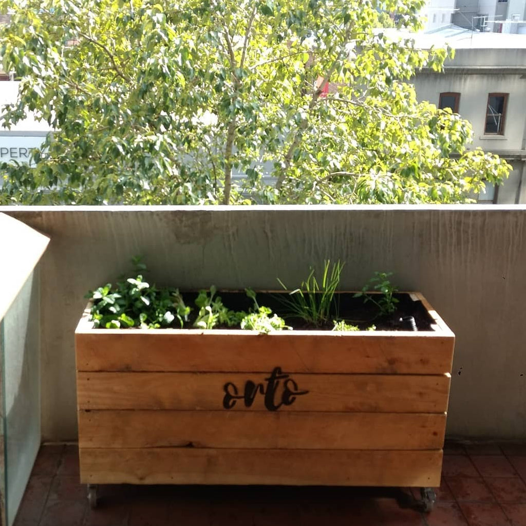 Outdoor timber planter wicking bed veggie garden in Melbourne.