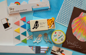 sticky page markers, bird paper clips, rainbow pencils