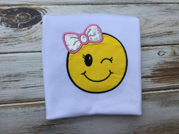Emoji bow wink face shirt or onesie.