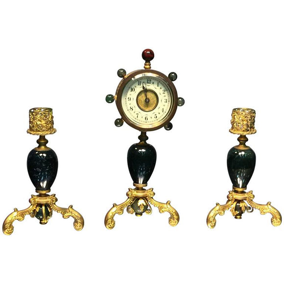 Glamorous Suite of Semiprecious Stone and Doré Bronze Clock and Candlesticks