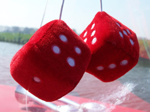 fuzzy red dice on dashboard