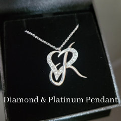 Custom diamond and platinum pendant initials necklace