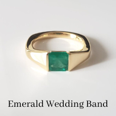 bespoke emerald tension set ring wedding band