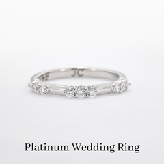 custom platinum wedding band with diamonds