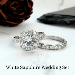 white sapphire engagement ring with halo