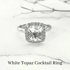 custom white topaz cocktail ring with halo