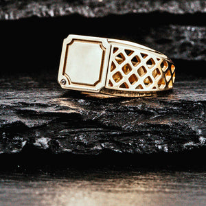 A square gold signet ring