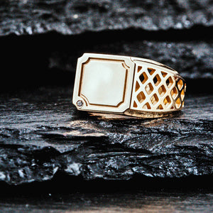 14K gold signet ring with a geometric pattern