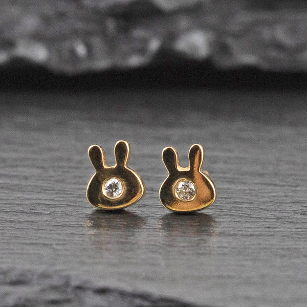 Yellow gold stud earrings shaped as a rabbit with diamonds