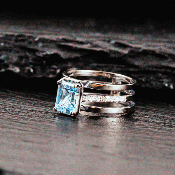 A diamond and aquamarine wedding ring