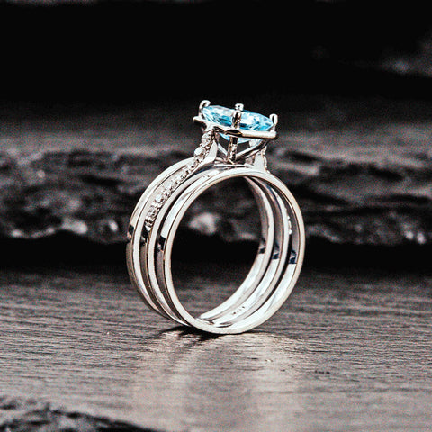 white gold engagement ring with aquamarine center stone and diamonds