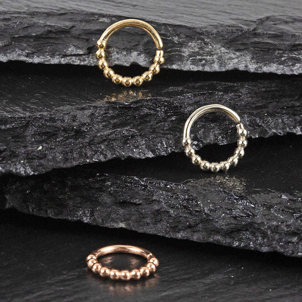 Helix ring, daith ring and septum ring in gold