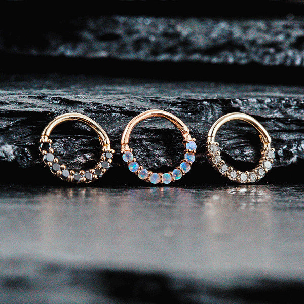 three gold septum rings side by side