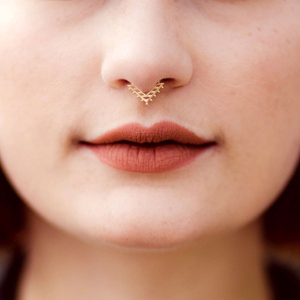 A women wearing a gold nose ring