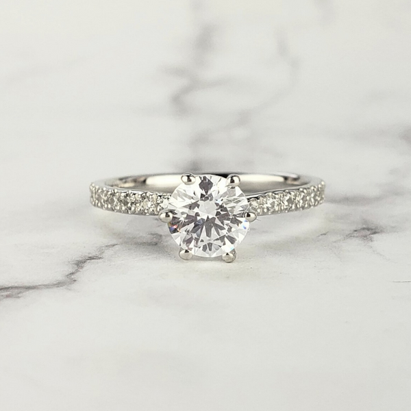 dainty solitaire diamond engagement ring