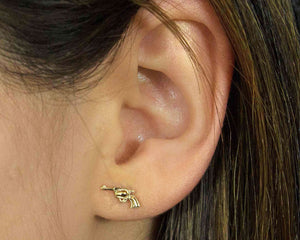 pistol earrings in gold