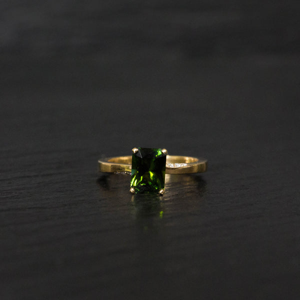 emerald cut center engagement ring with green tourmaline