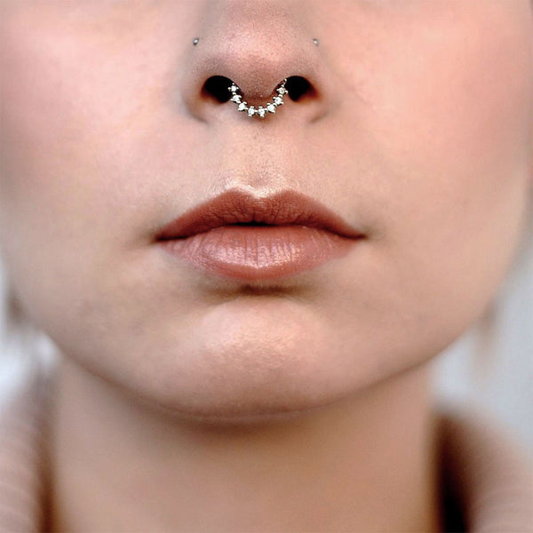 A women wearing a diamond and gold nose ring