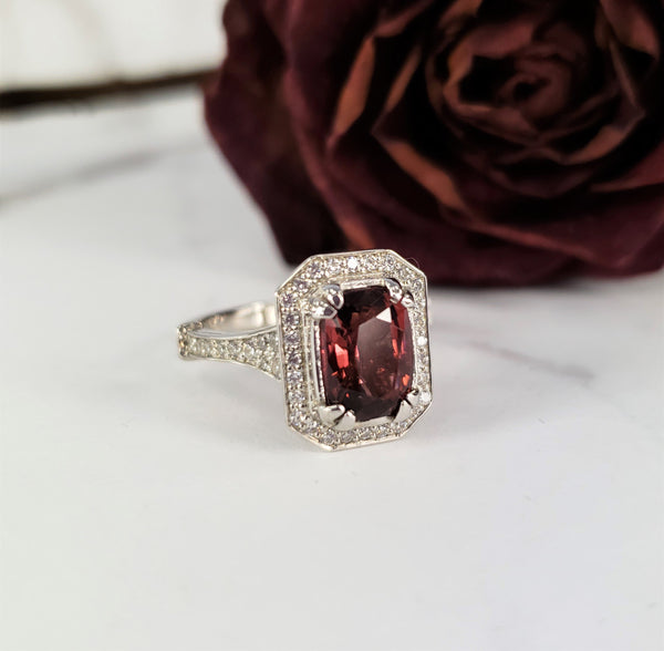 art deco engagement ring with diamond halo and tourmaline