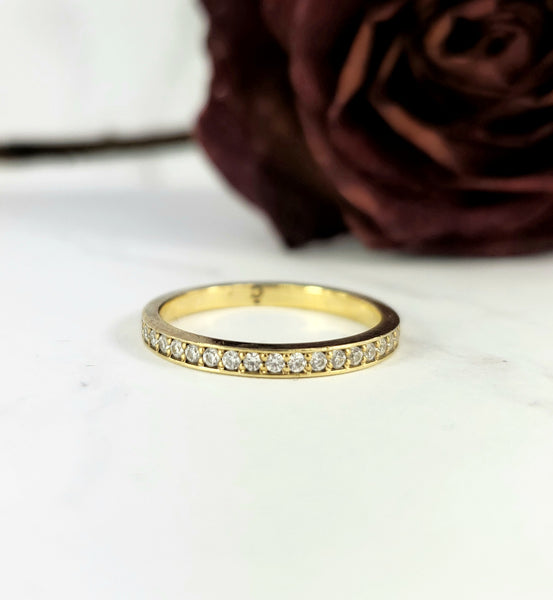 stackable wedding band in gold with diamonds