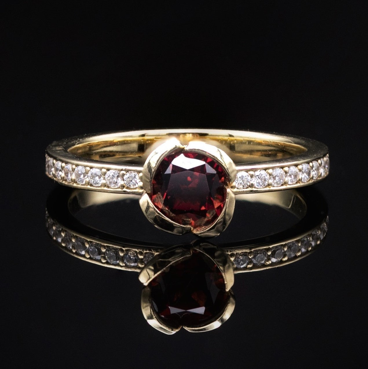 garnet engagement ring with diamonds