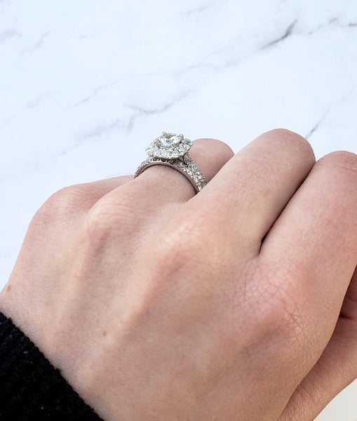 engagement ring with white sapphire halo