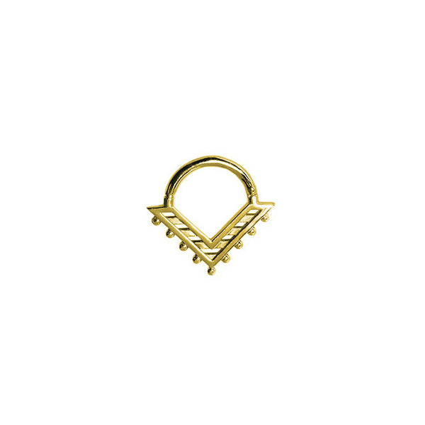 A gold septum clicker in the shape of a triangle