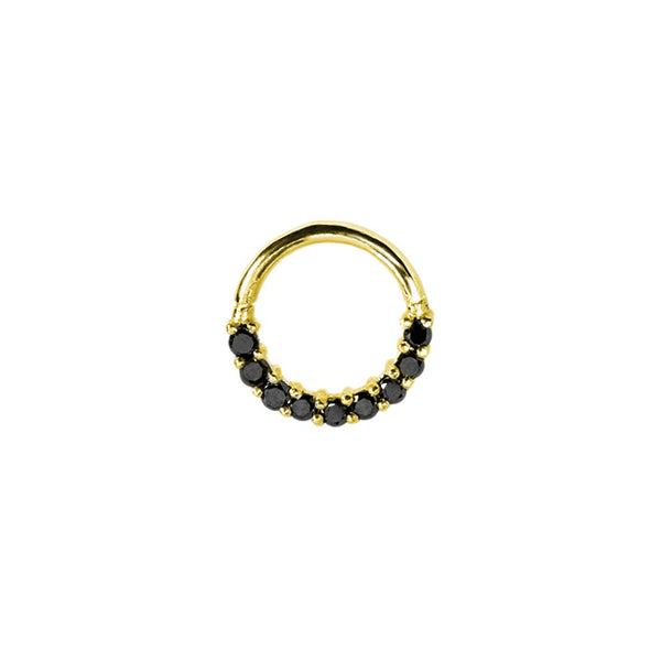 a yellow gold nose ring set with black diamonds