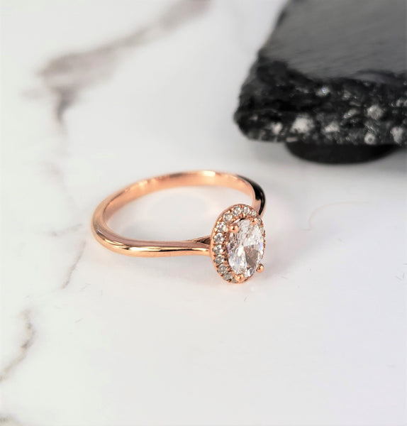 rose gold oval engagement ring diamond