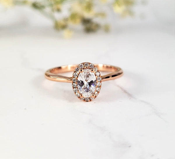 rose gold halo engagement ring with diamond