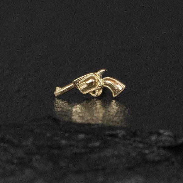 gun stud earrings in gold