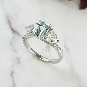 three stone diamond and aquamarine ring