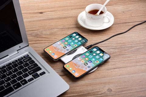 Image of Charging pad Charging two phones