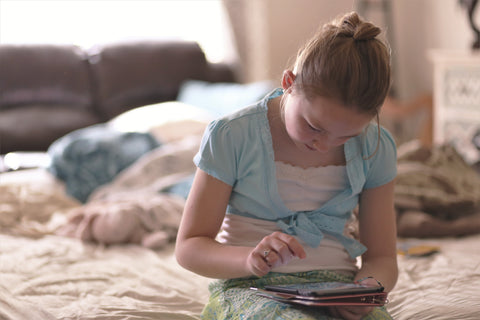 Image of child Playing with tablet