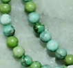 Green/blue chalk turquoise 4mm polished round beads 15 inch strand