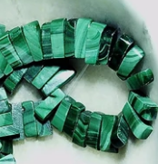 Artificial Malachite top-drilled 4mm x 10mm flat stick beads 15 inch strand . Unusual shape makes a collar effect.