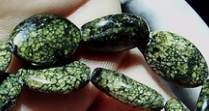 Jasper dark green 15mm x 10mm flat oval beads 16 inch strand